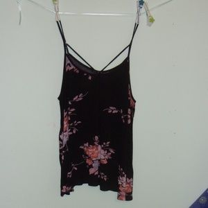 Black blouse with a flowery pattern.